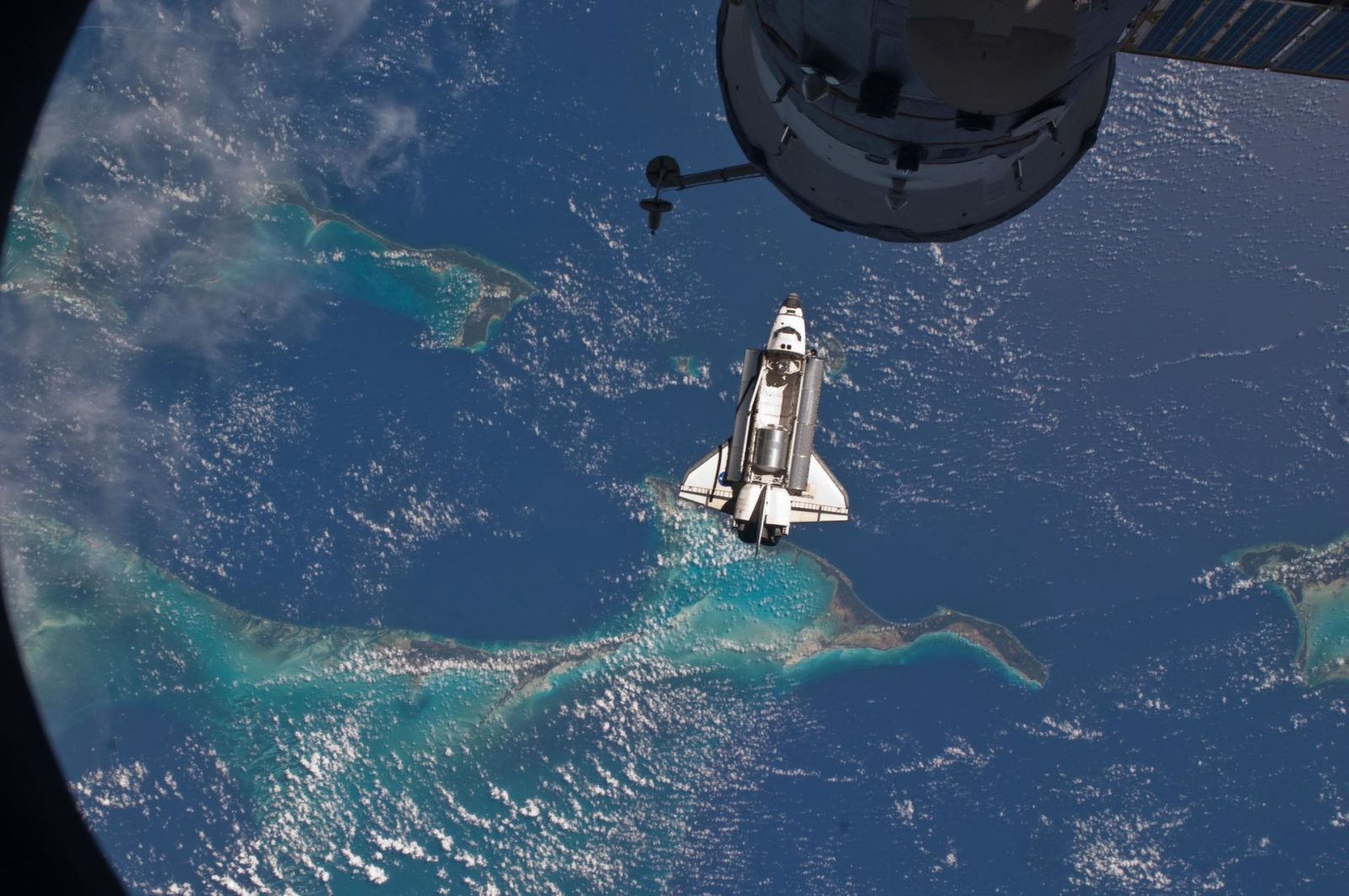 View of the Shuttle Atlantis during approach to the ISS
