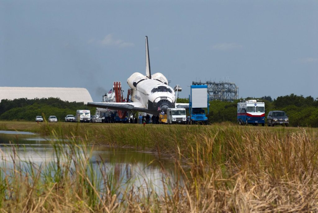 CAPE CANAVERAL, Fla. -- At NASA's Kennedy Space Center in Florida, the landing convoy vehicles accompany space shuttle Atlantis as it is slowly towed from the Shuttle Landing Facility to an orbiter processing facility. Atlantis' final return from space at 5:57 a.m. EDT concluded the STS-135 mission, secured the space shuttle fleet's place in history and brought a close to America's Space Shuttle Program. Main gear touchdown was at 5:57:00 a.m. EDT, followed by nose gear touchdown at 5:57:20 a.m., and wheelstop at 5:57:54 a.m. On board were STS-135 Commander Chris Ferguson, Pilot Doug Hurley, and Mission Specialists Sandra Magnus and Rex Walheim.    On the 37th shuttle mission to the International Space Station, STS-135 delivered the Raffaello multi-purpose logistics module filled with more than 9,400 pounds of spare parts, equipment and supplies that will sustain station operations for the next year. STS-135 was the 33rd and final flight for Atlantis, which has spent 307 days in space, orbited Earth 4,848 times and traveled 125,935,769 miles, and also the final mission of the Space Shuttle Program.  For more information, visit www.nasa.gov/mission_pages/shuttle/shuttlemissions/sts135/index.html. Photo credit: NASA/Kim Shiflett KSC-2011-5810