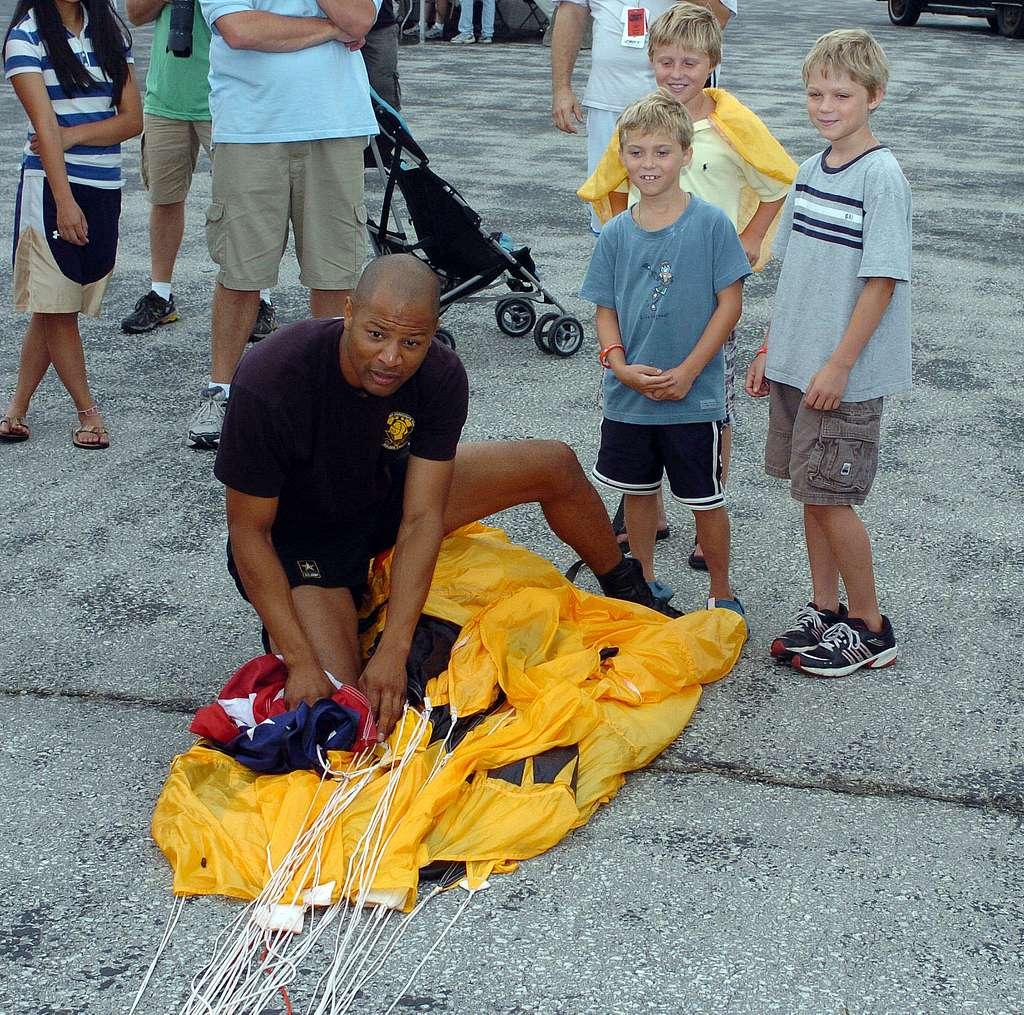 Staff Sgt. Noah Watts instructs children helpers on