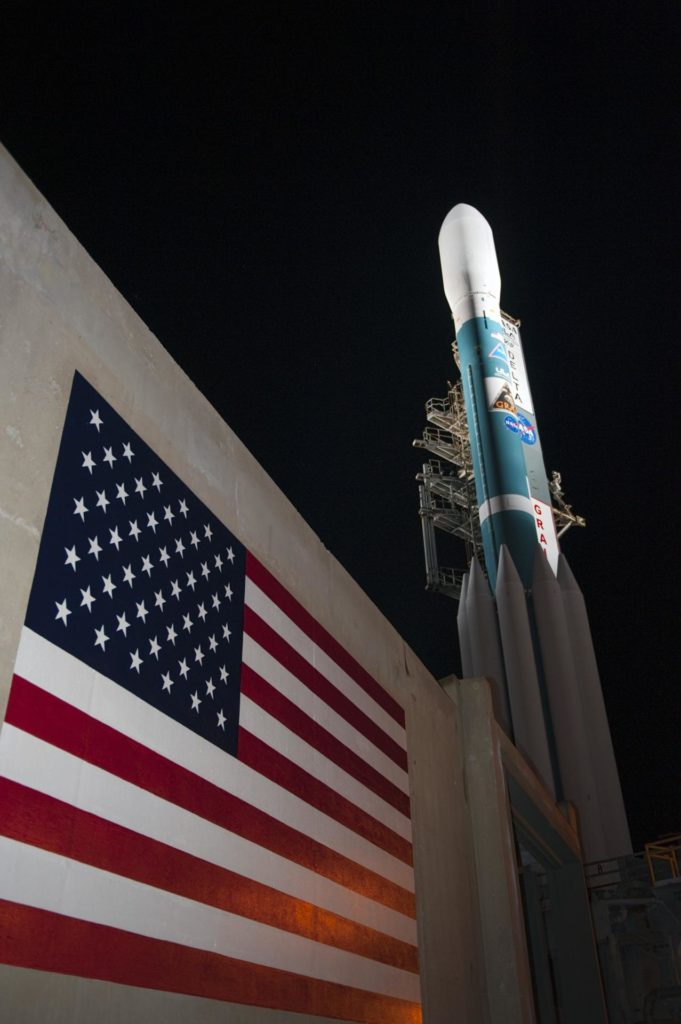 "CAPE CANAVERAL, Fla. -- At Space Launch Complex 17B on Cape Canaveral Air Force Station, the United Launch Alliance Delta II rocket that will launch NASA's Gravity Recovery and Interior Laboratory mission towers over the U.S. flag painted on the pad's structure.  The mobile service tower has been rolled away from the vehicle for launch.  The ""rollback"" began at about 11:20 p.m. EDT Sept. 7.    GRAIL will fly twin spacecraft in tandem around the moon to precisely measure and map variations in the moon's gravitational field. The mission will provide the most accurate global gravity field to date for any planet, including Earth. This detailed information will reveal differences in the density of the moon's crust and mantle and will help answer fundamental questions about the moon's internal structure, thermal evolution, and history of collisions with asteroids. The aim is to map the moon's gravity field so completely that future lunar vehicles can safely navigate anywhere on the moon's surface.  Launch is scheduled for 8:37:06 a.m. EDT Sept. 8.  For more information, visit http://www.nasa.gov/grail. Photo credit: NASA/Kim Shiflett KSC-2011-6782"