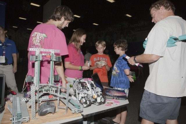 CAPE CANAVERAL, Fla. – Children participate in educational activities during Kennedy Space Center's Family Night, Sept. 10, at the U.S. Astronaut Hall of Fame in Florida.    NASA and the Kennedy Space Center Visitor Complex hosted the annual NASA family education night. The event, for fifth- through eighth-grade students and their parents, focuses on science, technology, engineering and mathematics (STEM) education activities that included astronaut appearances, a hovercraft, vortex cannon and alternative fuel vehicles. The back-to-school event is part of NASA's Summer of Innovation initiative to provide interactive learning experiences to middle school students nationwide.  Photo credit: NASA/Amanda Diller KSC-2011-6965