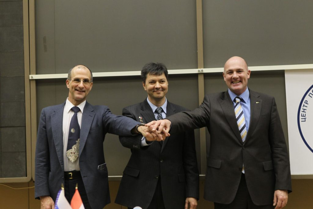 At the Gagarin Cosmonaut Training Center in Star City, Russia, the next trio to launch to the International Space Station pose for pictures during their traditional crew news conference Dec. 1, 2011. From left to right are Expedition 30 NASA Flight Engineer Don Pettit, Flight Engineer Andre Kuipers of the European Space Agency and Soyuz Commander Oleg Kononenko. The crewmembers will launch from the Baikonur Cosmodrome in Kazakhstan on Dec. 21 on their Soyuz TMA-03M spacecraft.  Credit: NASA jsc2011e212755