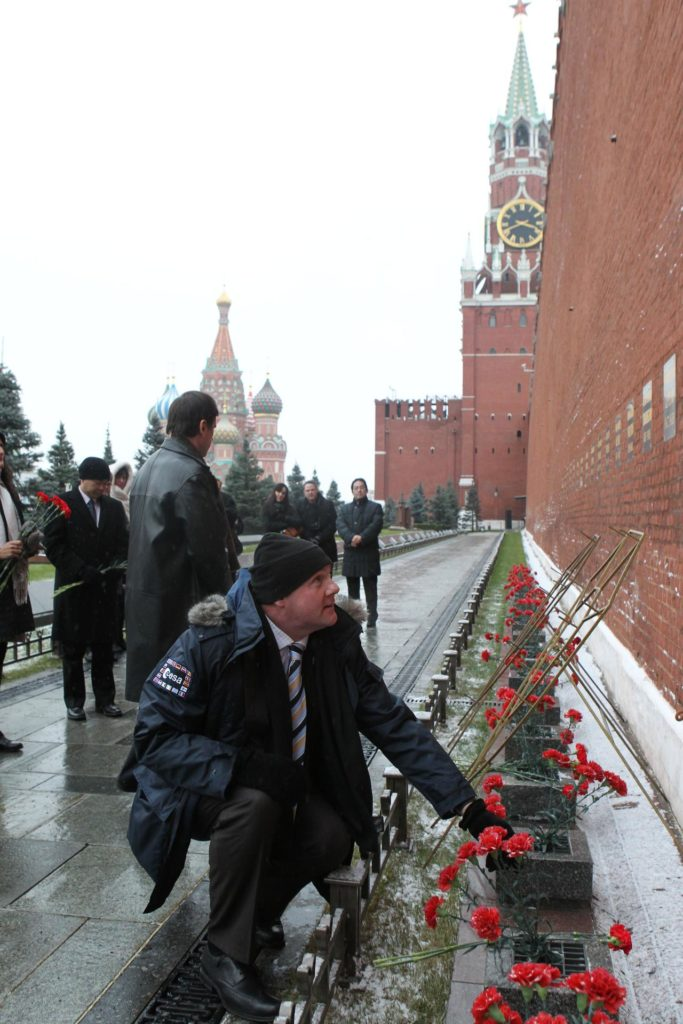 At the Kremlin Wall in Moscow, Expedition 30 Flight Engineer Andre Kuipers of the European Space Agency prepares to lay flowers at the site where Russian space heroes are interred during a traditional ceremony Dec. 1, 2011. Kuipers, Soyuz Commander Oleg Kononenko and NASA Flight Engineer Don Pettit will launch on Dec. 21 from the Baikonur Cosmodrome in Kazakhstan on their Soyuz TMA-03M spacecraft to the International Space Station.  Credit: NASA jsc2011e212759