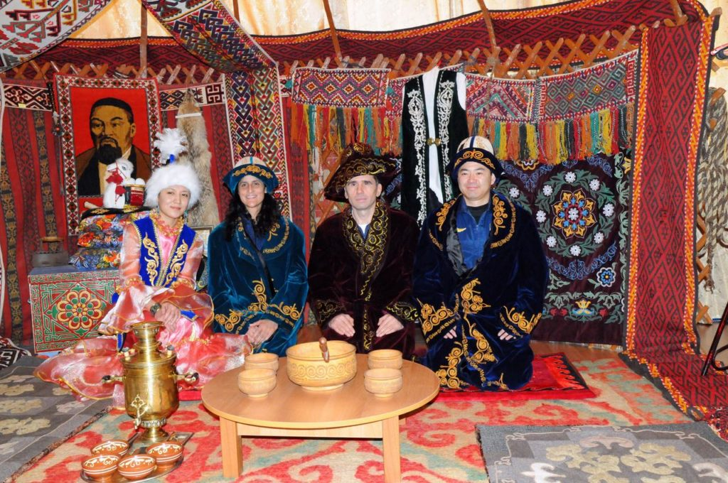 The Expedition 30 backup crewmembers pose for pictures with a Kazakh host inside a model of a primitive Kazakh hut-type house during a tour of a museum near their launch site in Baikonur, Kazakhstan Dec. 11, 2011. Clad in traditional Kazakh garb are backup Flight Engineer Suni Williams of NASA (second from the left), backup Soyuz Commander Yuri Malenchenko and backup Flight Engineer Aki Hoshide of the Japan Aerospace Exploration Agency. The prime crewmembers, NASA's Don Pettit, Oleg Kononenko and Andre Kuipers of the European Space Agency will launch to the International Space Station Dec. 21 from the Baikonur Cosmodrome in their Soyuz TMA-03M spacecraft.  Credit: NASA jsc2011e215646