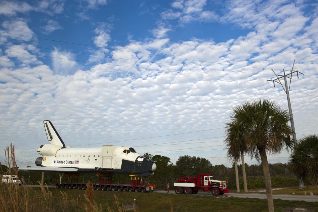 CAPE CANAVERAL, Fla. – The high-fidelity space shuttle model that was on display at the NASA Kennedy Space Center Visitor Complex in Florida creeps along the on-ramp from NASA Causeway to Kennedy Parkway to gain entrance to the northbound roadways on the center.  It is standard procedure for large payloads and equipment to travel against the normal flow of traffic under the supervision of a move crew when being transported on or off center property. The model is being moved from the visitor complex to NASA Kennedy Space Center's Launch Complex 39 turn basin.  The shuttle was part of a display at the visitor complex that also included an external tank and two solid rocket boosters that were used to show visitors the size of actual space shuttle components. The full-scale shuttle model is being transferred from Kennedy to Space Center Houston, NASA Johnson Space Center's visitor center. The model will stay at the turn basin for a few months until it is ready to be transported to Texas via barge. The move also helps clear the way for the Kennedy Space Center Visitor Complex to begin construction of a new facility next year to display space shuttle Atlantis in 2013.  For more information about Space Center Houston, visit http://www.spacecenter.org.  Photo credit: NASA/Dimitri Gerondidakis KSC-2011-8239