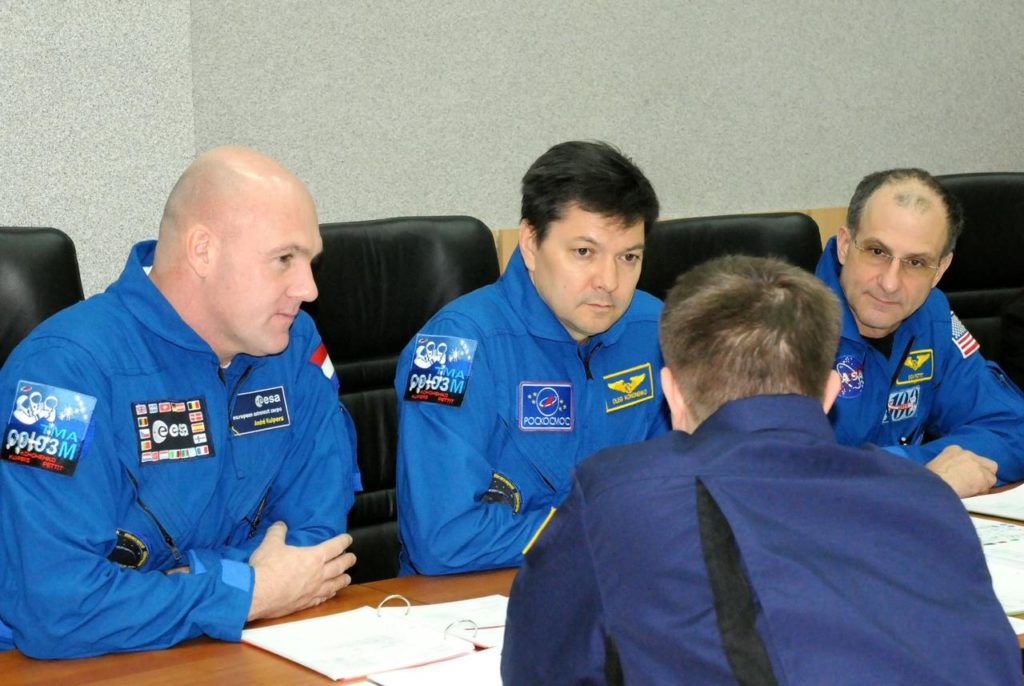 At their crew quarters at the Cosmonaut Hotel in Baikonur, Kazakhstan, Expedition 30 Flight Engineer Andre Kuipers of the European Space Agency (left), Soyuz Commander Oleg Kononenko (center) and NASA Flight Engineer Don Pettit (right) listen to a review of flight data file information from a training instructor Dec. 15, 2011 as the trio prepares for launch Dec. 21 to the International Space Station in their Soyuz TMA-03M spacecraft from Baikonur.  Credit: NASA jsc2011e215982