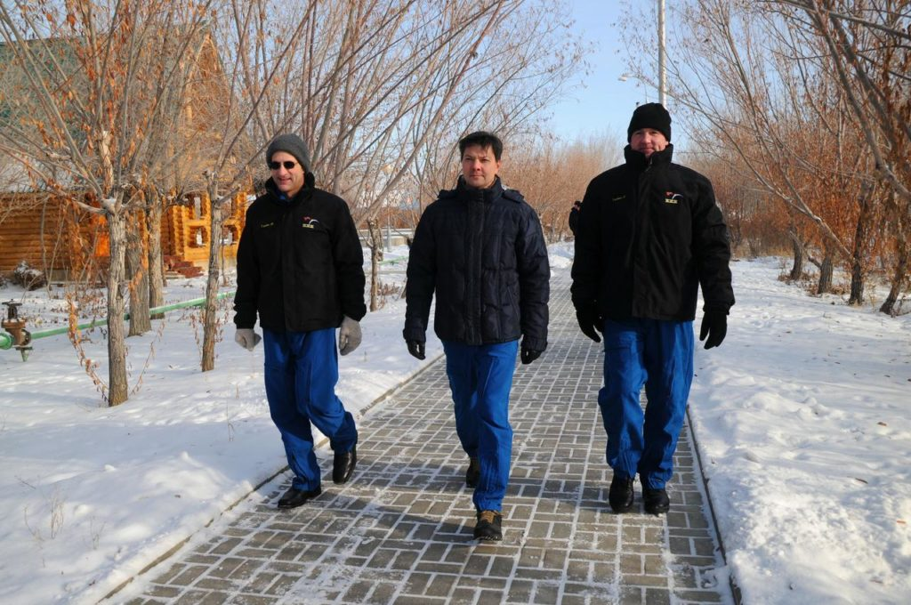 Braced against the cold of single digit temperatures, Expedition 30 NASA Flight Engineer Don Pettit (left), Soyuz Commander Oleg Kononenko (center) and Flight Engineer Andre Kuipers of the European Space Agency (right) take a walk on the grounds of their Cosmonaut Hotel crew quarters in Baikonur, Kazakhstan Dec. 15, 2011 as they prepare for launch on Dec. 21 in their Soyuz TMA-03M spacecraft from Baikonur to the International Space Station.  Credit: NASA jsc2011e215983
