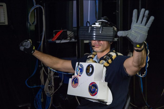 DATE: 1-22-13 LOCATION:  Bldg. 9 - VR Lab  SUBJECT: Expedition 36 crew Chris Cassidy, Karen Nyberg and Luca Parmitano during EVA robotics training in the VR Lab. PHOTOGRAPHER: Lauren Harnett jsc2013e007743