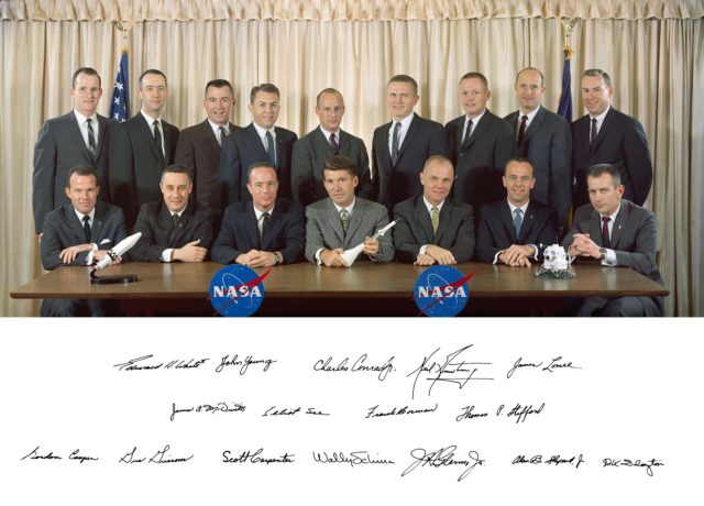 S63-01419A (1963) --- Portrait of the first two groups of astronauts. The seven original Mercury astronauts plus new members of the astronaut corps. Seated from left to right are: Gordon Cooper, Gus Grissom, Scott Carpenter, Wally Schirra, John Glenn, Alan Shepard and Deke Slayton. Standing from left to right are: Edward White, James McDivitt, John Young, Elliot See, Charles Conrad, Frank Borman, Neil Armstrong, Thomas Stafford, and James Lovell. Signatures are also visible at the bottom of the frame. Photo credit: NASA s63-01419a