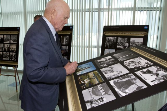 "CAPE CANAVERAL, Fla. - Mercury astronaut John Glenn signs a poster celebrating 50 years of Americans in orbit, an era which began with Glenn's Mercury mission MA-6, on Feb. 20, 1962.  Glenn's launch aboard an Atlas rocket took with it the hopes of an entire nation and ushered in a new era of space travel that eventually led to Americans walking on the moon by the end of the 1960s. Glenn soon was followed into orbit by Scott Carpenter, Walter Schirra and Gordon Cooper. Their fellow Mercury astronauts Alan Shepard and Virgil ""Gus"" Grissom flew earlier suborbital flights. Deke Slayton, a member of NASA's original Mercury 7 astronauts, was grounded by a medical condition until the Apollo-Soyuz Test Project in 1975. Photo credit: NASA/Kim Shiflett KSC-2012-1432"