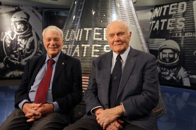 "CAPE CANAVERAL, Fla. -- Mercury astronauts Scott Carpenter, left, and John Glenn sit in front of a capsule from the Mercury program on display at the Kennedy Space Center Visitor Complex in Florida. The two astronauts, part of the original class of seven astronauts chosen by NASA, were taking part in events celebrating 50 years of Americans in orbit, an era which began with Glenn's Mercury mission MA-6, on Feb. 20, 1962.  Glenn's launch aboard an Atlas rocket took with it the hopes of an entire nation and ushered in a new era of space travel that eventually led to Americans walking on the moon by the end of the 1960s. Glenn soon was followed into orbit by Carpenter, Walter Schirra and Gordon Cooper. Their fellow Mercury astronauts Alan Shepard and Virgil ""Gus"" Grissom flew earlier suborbital flights. Deke Slayton was grounded by a medical condition until the Apollo-Soyuz Test Project in 1975. Photo credit: NASA/Kim Shiflett KSC-2012-1434"