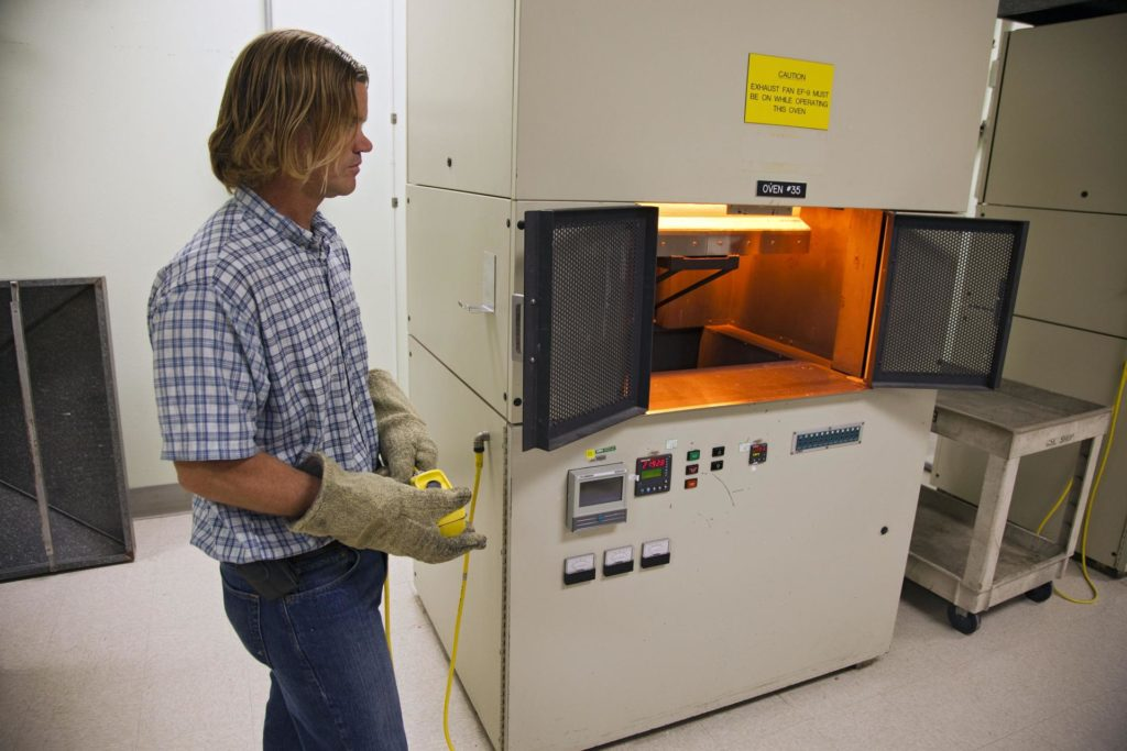 CAPE CANAVERAL, Fla. -- Tim Wright, a United Space Alliance engineering manager at NASA's Kennedy Space Center in Florida, put the heat shield tiles that will be installed to the backshell of the Orion Multi-Purpose Crew Vehicle's Exploration Flight Test EFT-1 capsule in a Keith thermal automation oven. The tiles will be baked at 2,200 degrees F to cure their ceramic coating. The work to manufacture and inspect the tiles is taking place in Kennedy's Thermal Protection System Facility. EFT-1 will be used during Orion's first test flight in space. For more information, visit www.nasa.gov/orion. Photo credit: Frankie Martin KSC-2012-1574