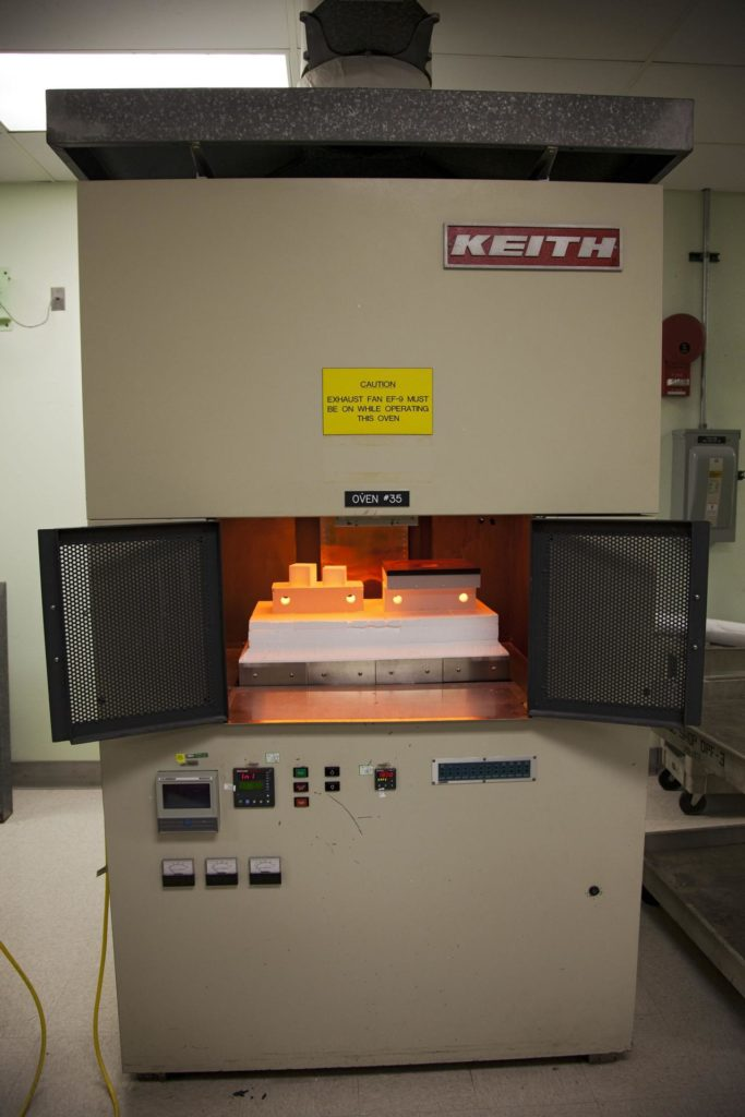 CAPE CANAVERAL, Fla. -- The heat shield tiles that will be installed to the backshell of the Orion Multi-Purpose Crew Vehicle's Exploration Flight Test EFT-1 capsule are in a Keith thermal automation oven in the Thermal Protection System Facility at NASA's Kennedy Space Center in Florida. Inside the oven, the tiles will be baked at 2,200 degrees F to cure their ceramic coating. EFT-1 will be used during Orion's first test flight in space. For more information, visit www.nasa.gov/orion. Photo credit: Frankie Martin KSC-2012-1575