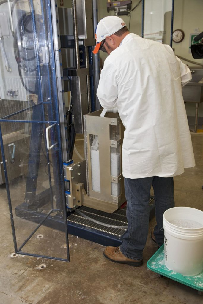CAPE CANAVERAL, Fla. -- Chris Keeling, a United Space Alliance technician at NASA's Kennedy Space Center in Florida, manufactures the heat shield tiles that will be installed to the backshell of the Orion Multi-Purpose Crew Vehicle's Exploration Flight Test EFT-1 capsule. The work to manufacture and inspect the tiles is taking place in Kennedy's Thermal Protection System Facility. EFT-1 will be used during Orion's first test flight in space. For more information, visit www.nasa.gov/orion. Photo credit: Frankie Martin KSC-2012-1582