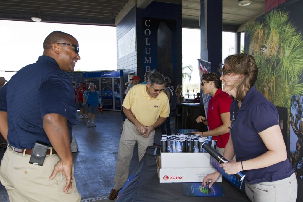 VIERA, Fla. – From left, Kelvin Manning, associate director of NASA's Kennedy Space Center, and Bob Cabana, director of the center, visit the NASA booth on Space Day at the Space Coast Stadium where information on some of the contributions the space agency has made to sports, transportation and everyday life is being distributed to baseball fans attending the stadium's Space Day.  Cabana was on hand to throw the first pitch of a spring training game between Major League Baseball's Washington Nationals and the Houston Astros. A full-scale test version of NASA's new Orion Multi-Purpose Crew Vehicle was on display outside the stadium for the occasion to show the public the spacecraft under development that will take astronauts farther into space than ever before.    For more information, visit http://www.nasa.gov/kennedy.  Photo credit: NASA/Kim Shiflett KSC-2012-1686