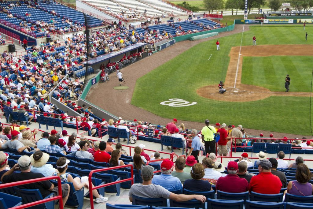 VIERA, Fla. – Baseball fans are on hand for Space Day at the Space Coast Stadium. Bob Cabana, director of NASA's Kennedy Space Center in Florida, was on hand to throw the first pitch of a spring training game between Major League Baseball's Washington Nationals and the Houston Astros. Kennedy set up a booth at the stadium for the occasion to highlight some of the contributions the space agency has made to sports, transportation and everyday life.  A full-scale test version of NASA's new Orion Multi-Purpose Crew Vehicle also was located outside the stadium to show the public the spacecraft under development that will take astronauts farther into space than ever before.    For more information, visit http://www.nasa.gov/kennedy.  Photo credit: NASA/Kim Shiflett KSC-2012-1695