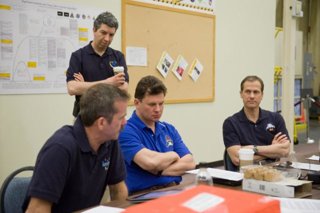 DATE: 3-22-12 LOCATION: Bldg. 9NW - ISS Mockups SUBJECT: Expedition 34 crew Chris Hadfield, Roman Romanenko and Tom Marshburn during emergency scenarios training in the ISS mockups with instructor Kathryn Bolt PHOTOGRAPHER: Lauren Harnett jsc2012e036721