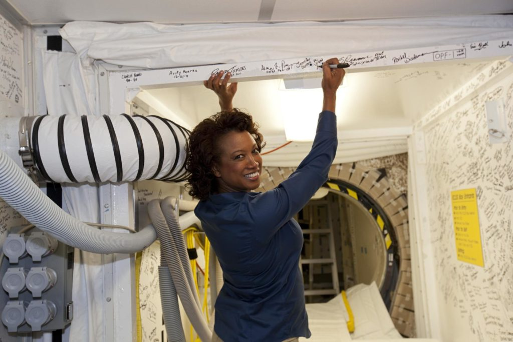 """CAPE CANAVERAL, Fla. – Florida's Lt. Gov. Jennifer Carroll signs a wall of the White Room during a tour of Kennedy Space Center's Orbiter Processing Facility-1.  The room affords access to the shuttle as it is undergoing processing in the facility. Everyone visiting the interior of the shuttle – astronauts, technicians and guests alike - is given the opportunity to """"autograph"""" a wall of the room.     The tour coincided with Carroll's visit to Kennedy for a meeting with Cabana. Atlantis is being prepared for public display at the Kennedy Space Center Visitor Complex in 2013. The groundbreaking for Atlantis' exhibit hall took place in January Atlantis is scheduled to be moved to the visitor complex in November. For more information, visit http://www.nasa.gov/shuttle.  Photo credit: NASA/Jim Grossmann KSC-2012-1966"""