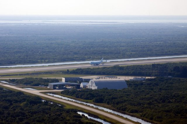 CAPE CANAVERAL, Fla. – NASA pilot Jeff Moultrie guides the Shuttle Carrier Aircraft along the runway at the Shuttle Landing Facility at NASA's Kennedy Space Center in Florida.    The aircraft, known as an SCA, arrived at 5:35 p.m. EDT to prepare for shuttle Discovery's ferry flight to the Washington Dulles International Airport in Sterling, Va., on April 17. This SCA, designated NASA 905, is a modified Boeing 747 jet airliner, originally manufactured for commercial use. One of two SCAs employed over the course of the Space Shuttle Program, NASA 905 is assigned to the remaining ferry missions, delivering the shuttles to their permanent public display sites.  NASA 911 was decommissioned at the NASA Dryden Flight Research Center in California in February. Discovery will be placed on permanent public display in the Smithsonian's National Air and Space Museum Steven F. Udvar-Hazy Center in Chantilly, Va.  For more information on the SCA, visit http://www.nasa.gov/centers/dryden/news/FactSheets/FS-013-DFRC.html. For more information on shuttle transition and retirement activities, visit http://www.nasa.gov/shuttle. Photo credit: NASA/Jim Grossmann KSC-2012-2010