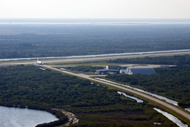 CAPE CANAVERAL, Fla. – NASA pilot Jeff Moultrie guides the Shuttle Carrier Aircraft toward the apron of the runway at the Shuttle Landing Facility at NASA's Kennedy Space Center in Florida.    The aircraft, known as an SCA, arrived at 5:35 p.m. EDT to prepare for shuttle Discovery's ferry flight to the Washington Dulles International Airport in Sterling, Va., on April 17. This SCA, designated NASA 905, is a modified Boeing 747 jet airliner, originally manufactured for commercial use. One of two SCAs employed over the course of the Space Shuttle Program, NASA 905 is assigned to the remaining ferry missions, delivering the shuttles to their permanent public display sites.  NASA 911 was decommissioned at the NASA Dryden Flight Research Center in California in February. Discovery will be placed on permanent public display in the Smithsonian's National Air and Space Museum Steven F. Udvar-Hazy Center in Chantilly, Va.  For more information on the SCA, visit http://www.nasa.gov/centers/dryden/news/FactSheets/FS-013-DFRC.html. For more information on shuttle transition and retirement activities, visit http://www.nasa.gov/shuttle. Photo credit: NASA/Jim Grossmann KSC-2012-2011