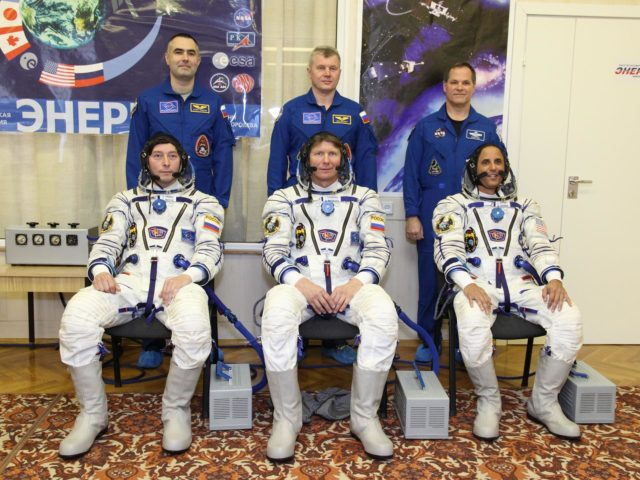 "At the Baikonur Cosmodrome in Kazakhstan, the Expedition 31/32 prime and backup crewmembers pose for pictures during their suited ""fit check"" dress rehearsal of launch day activities in advance of a May 15 launching in the Soyuz TMA-04M spacecraft to the International Space Station. Seated from left to right in their ""Sokol"" launch and entry suits are Russian Flight Engineer Sergei Revin, Soyuz Commander Gennady Padalka and NASA Flight Engineer Joe Acaba. Standing behind them from left to right are backup crewmembers Evgeny Tarelkin, Oleg Novitskiy and Kevin Ford.  NASA/Victor Zelentsov jsc2012e049720"