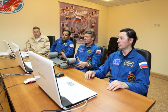 "At their Cosmonaut Hotel crew quarters in Baikonur, Kazakhstan, the next trio of crewmembers who will launch to the International Space Station brush up on rendezvous techniques May 10, 2012 by ""flying"" an approach to the station on a laptop computer simulator as they prepare for liftoff. With their instructor (far left) are Expedition 31/32 Flight Engineer Joe Acaba of NASA (second from left), Soyuz Commander Gennady Padalka and Flight Engineer Sergei Revin (right). They will launch May 15 on the Soyuz TMA-04M spacecraft from the Baikonur Cosmodrome to begin a four-month mission on the orbital outpost.  NASA/Victor Zelentsov jsc2012e051251"
