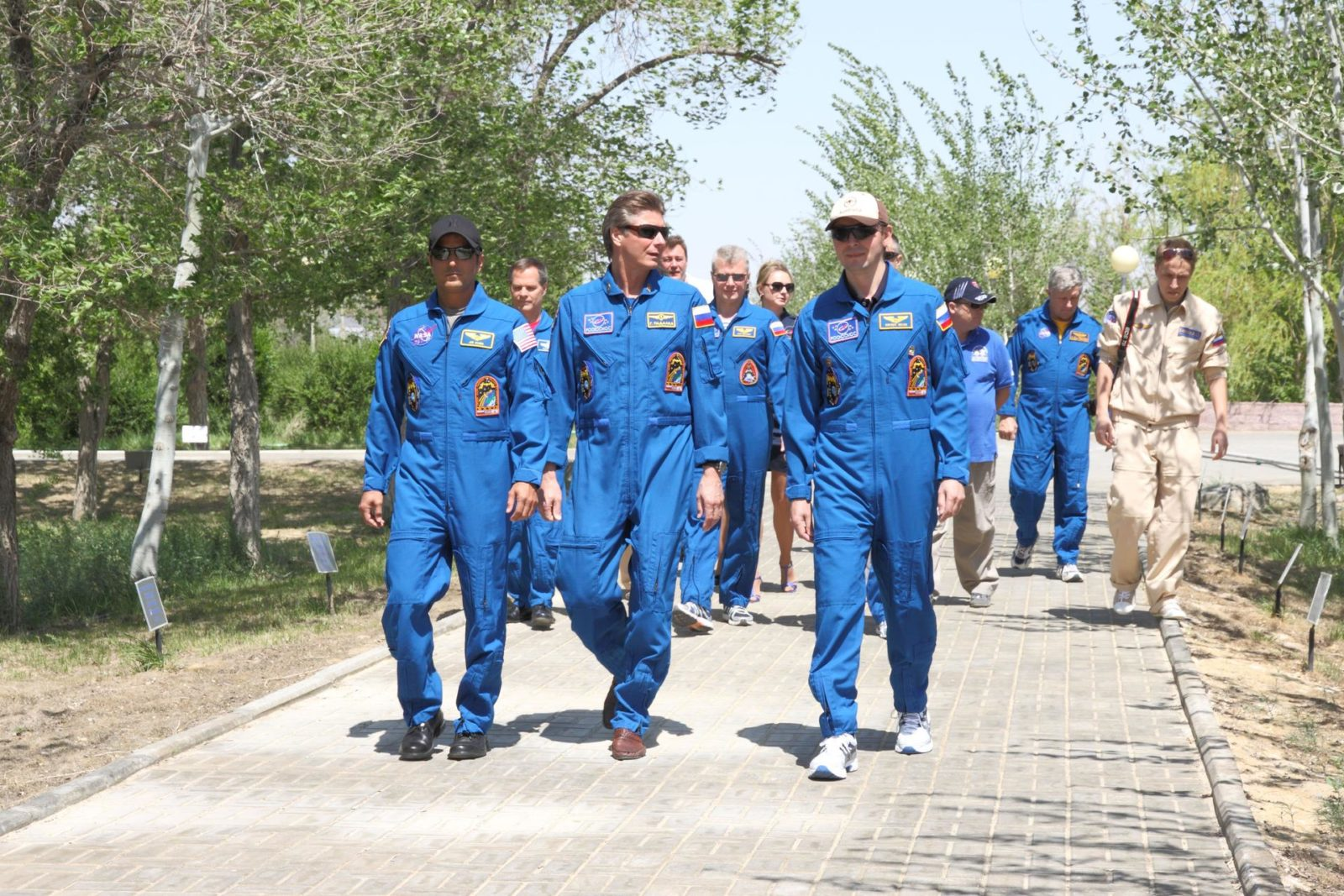 At their Cosmonaut Hotel crew quarters in Baikonur, Kazakhstan, the next trio of crewmembers who will launch to the International Space Station take a traditional stroll down the Walk of the Cosmonauts May 10, 2012 as they take break from final pre-launch training.  From left to right in the foreground are Expedition 31/32 Flight Engineer Joe Acaba of NASA, Soyuz Commander Gennady Padalka and Flight Engineer Sergei Revin, who enjoyed balmy weather as they wrap up preparations for launch May 15 on the Soyuz TMA-04M spacecraft from the Baikonur Cosmodrome to begin a four-month mission on the international outpost.  NASA/Victor Zelentsov jsc2012e051255