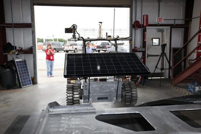 CAPE CANAVERAL, Fla. – In a test facility behind the Operations and Checkout Building at NASA's Kennedy Space Center in Florida, the prototype rover Artemis Jr. for NASA's Regolith and Environment Science and Oxygen and Lunar Volatile Extraction, or RESOLVE, project dismounts from the RESOLVE lander during a dry run using ramps attached to the prototype lander.    RESOLVE consists of a rover and drill provided by the Canadian Space Agency to support a NASA payload that is designed to prospect for water, ice and other lunar resources. RESOLVE also will demonstrate how future explorers can take advantage of resources at potential landing sites by manufacturing oxygen from soil. NASA will conduct field tests in July outside of Hilo, Hawaii, with equipment and concept vehicles that demonstrate how explorers might prospect for resources and make their own oxygen for survival while on other planetary bodies.  For more information, visit http://www.nasa.gov/exploration/analogs/index.html.  Photo credit: NASA/Dimitri Gerondidakis KSC-2012-3275