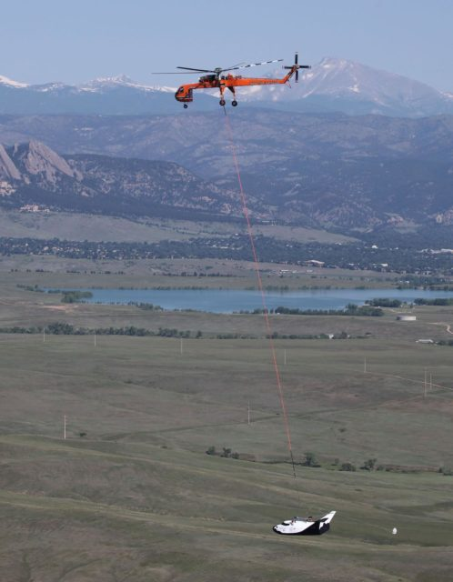 LOUISVILLE, Colo. – An Erickson Air-Crane helicopter lifts Sierra Nevada Corporation Space Systems' Dream Chaser full-scale test vehicle to verify proper aerodynamic flight performance near the Rocky Mountain Metropolitan Airport in Jefferson County, Colo. This captive-carry test is one of several milestones the company is meeting during its partnership with NASA's Commercial Crew Program CCP. Data from this test will provide SNC an early opportunity to evaluate and prove hardware, facilities and ground operations in preparation for approach and landing tests scheduled for later this year.     In 2011, NASA selected Sierra Nevada during Commercial Crew Development Round 2 CCDev2) activities to mature the design and development of a crew transportation system with the overall goal of accelerating a United States-led capability to the International Space Station. The goal of CCP is to drive down the cost of space travel as well as open up space to more people than ever before by balancing industry's own innovative capabilities with NASA's 50 years of human spaceflight experience. Six other aerospace companies also are maturing launch vehicle and spacecraft designs under CCDev2, including Alliant Techsystems Inc. ATK, The Boeing Co., Excalibur Almaz Inc., Blue Origin, Space Exploration Technologies SpaceX, and United Launch Alliance ULA. For more information, visit www.nasa.gov/commercialcrew. Image credit: Sierra Nevada Corp. KSC-2012-3149