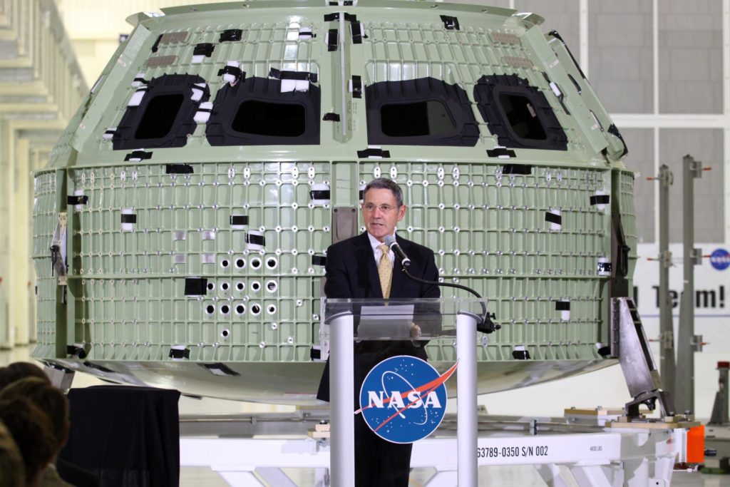 CAPE CANAVERAL, Fla. – NASA Kennedy Space Center Director Robert Cabana addresses the audience assembled in Kennedy Space Center's Operations and Checkout Building high bay for an event marking the arrival of NASA's first space-bound Orion capsule in Florida.    Slated for Exploration Flight Test-1, an uncrewed mission planned for 2014, the capsule will travel farther into space than any human spacecraft has gone in more than 40 years. The capsule was shipped to Kennedy from NASA's Michoud Assembly Facility in New Orleans where the crew module pressure vessel was built. The Orion production team will prepare the module for flight at Kennedy by installing heat-shielding thermal protection systems, avionics and other subsystems. For more information, visit http://www.nasa.gov/orion.  Photo credit: NASA/Kim Shiflett KSC-2012-3626
