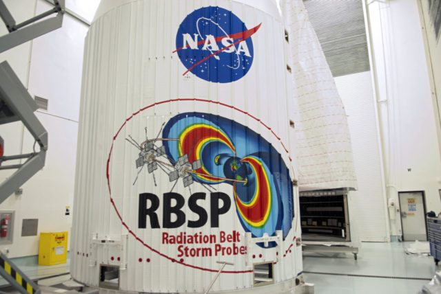 CAPE CANAVERAL, Fla. - Inside the Astrotech payload processing facility near NASA's Kennedy Space Center in Florida, the nose cone fairing for the Radiation Belt Storm Probes, or RBSP, spacecraft includes an artistic depiction of the probe's mission. The nose faring will house and protect the RBSP during liftoff aboard an Atlas V rocket.      NASA's RBSP mission will help us understand the sun's influence on Earth and near-Earth space by studying the Earth's radiation belts on various scales of space and time. RBSP will begin its mission of exploration of Earth's Van Allen radiation belts and the extremes of space weather after its liftoff aboard a United Launch Alliance Atlas V from Space Launch Complex 41 at Cape Canaveral Air Force Station, Fla. Liftoff is targeted for Aug. 23, 2012. For more information, visit http://www.nasa.gov/rbsp. Photo credit: NASA/Charisse Nahser KSC-2012-3808
