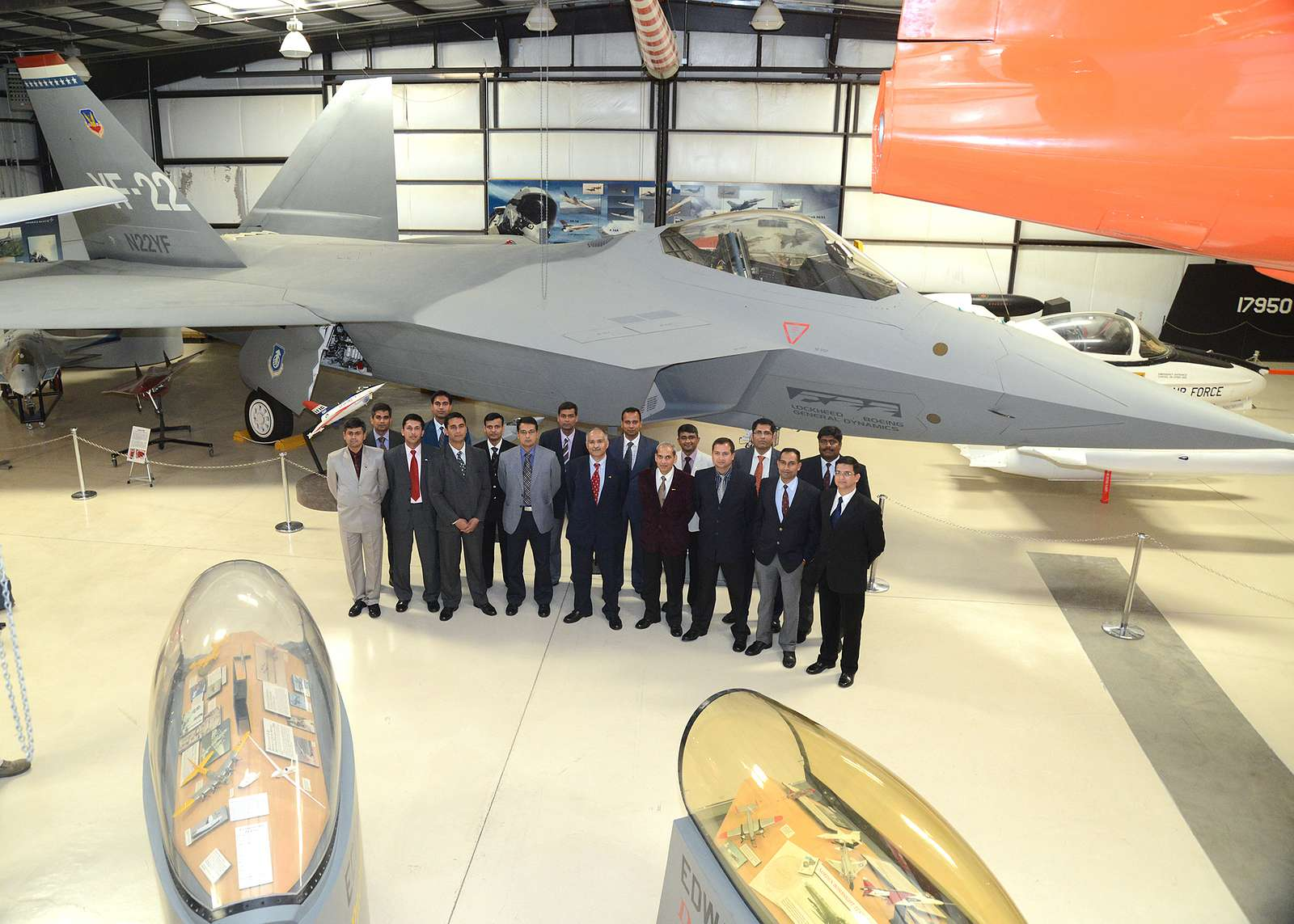Seventeen members of the senior class from India's Test Pilot School pose for a photo in front of the YF-22 at the Air Force Flight Test Museum.