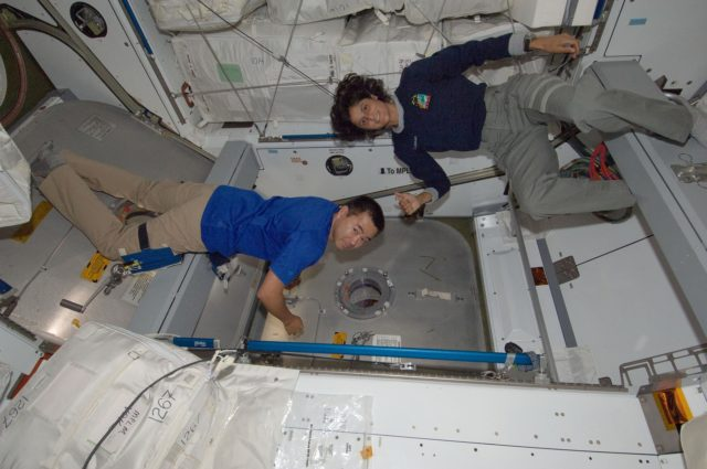 Expedition 32 Crew Members check the HTV3 Vestibule