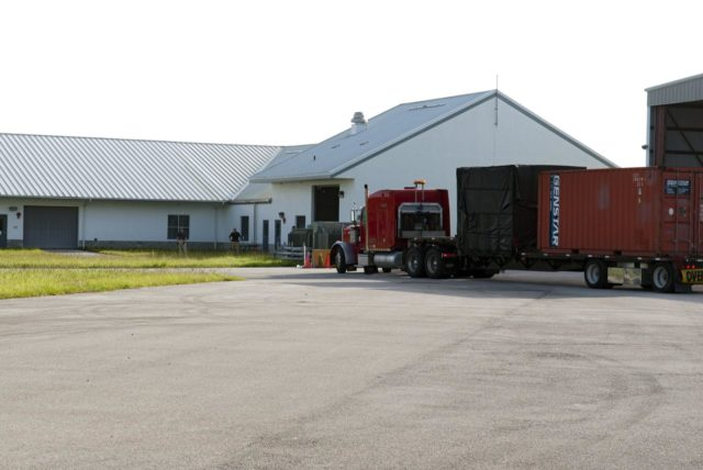 CAPE CANAVERAL, Fla. - A truck transporting NASA's Morpheus lander, a vertical test bed vehicle, arrives at a building at the Shuttle Landing Facility, or SLF, at the Kennedy Space Center in Florida for unloading. Morpheus is designed to demonstrate new green propellant propulsion systems and autonomous landing and an Autonomous Landing and Hazard Avoidance Technology, or ALHAT, system.      Checkout of the prototype lander has been ongoing at NASA's Johnson Space Center in Houston in preparation for its first free flight. The SLF site will provide the lander with the kind of field necessary for realistic testing. Project Morpheus is one of 20 small projects comprising the Advanced Exploration Systems, or AES, program in NASA's Human Exploration and Operations Mission Directorate. AES projects pioneer new approaches for rapidly developing prototype systems, demonstrating key capabilities and validating operational concepts for future human missions beyond Earth orbit. For more information on Project Morpheus, visit http://www.nasa.gov/centers/johnson/exploration/morpheus/index.html  Photo credit: NASA/ Charisse Nahser KSC-2012-4010
