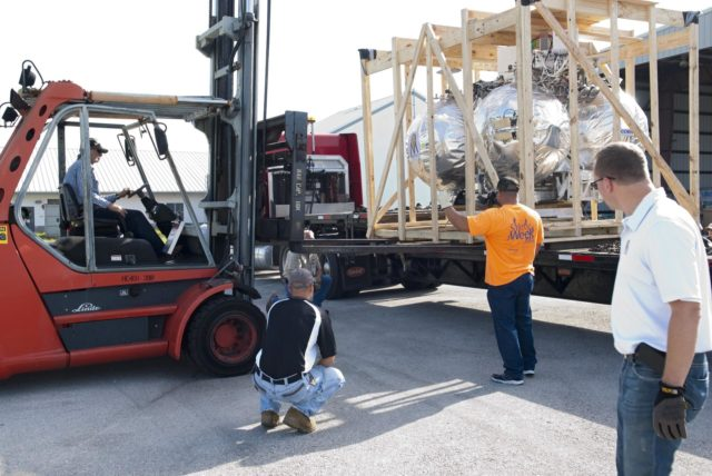 CAPE CANAVERAL, Fla. - NASA's Morpheus lander, a vertical test bed vehicle, is unloaded at a building at the Shuttle Landing Facility, or SLF, at the Kennedy Space Center in Florida. Morpheus is designed to demonstrate new green propellant propulsion systems and autonomous landing and an Autonomous Landing and Hazard Avoidance Technology, or ALHAT, system.      Checkout of the prototype lander has been ongoing at NASA's Johnson Space Center in Houston in preparation for its first free flight. The SLF site will provide the lander with the kind of field necessary for realistic testing. Project Morpheus is one of 20 small projects comprising the Advanced Exploration Systems, or AES, program in NASA's Human Exploration and Operations Mission Directorate. AES projects pioneer new approaches for rapidly developing prototype systems, demonstrating key capabilities and validating operational concepts for future human missions beyond Earth orbit. For more information on Project Morpheus, visit http://www.nasa.gov/centers/johnson/exploration/morpheus/index.html  Photo credit: NASA/ Charisse Nahser KSC-2012-4016