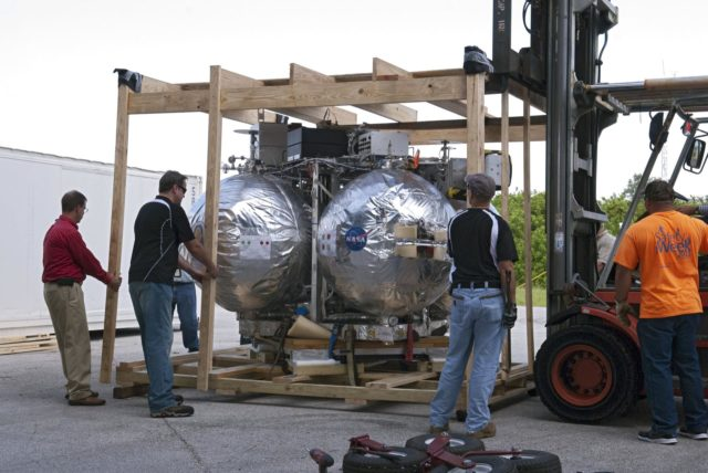 CAPE CANAVERAL, Fla. - NASA's Morpheus lander, a vertical test bed vehicle, is uncrated after unloading at the Kennedy Space Center in Florida. Morpheus is designed to demonstrate new green propellant propulsion systems and autonomous landing and an Autonomous Landing and Hazard Avoidance Technology, or ALHAT, system.      Checkout of the prototype lander has been ongoing at NASA's Johnson Space Center in Houston in preparation for its first free flight. The SLF site will provide the lander with the kind of field necessary for realistic testing. Project Morpheus is one of 20 small projects comprising the Advanced Exploration Systems, or AES, program in NASA's Human Exploration and Operations Mission Directorate. AES projects pioneer new approaches for rapidly developing prototype systems, demonstrating key capabilities and validating operational concepts for future human missions beyond Earth orbit. For more information on Project Morpheus, visit http://www.nasa.gov/centers/johnson/exploration/morpheus/index.html  Photo credit: NASA/ Charisse Nahser KSC-2012-4020