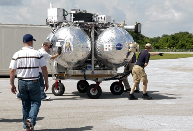 CAPE CANAVERAL, Fla. - NASA's Morpheus lander, a vertical test bed vehicle, is moved into a building at the Shuttle Landing Facility, or SLF, at the Kennedy Space Center in Florida. Morpheus is designed to demonstrate new green propellant propulsion systems and autonomous landing and an Autonomous Landing and Hazard Avoidance Technology, or ALHAT, system.      Checkout of the prototype lander has been ongoing at NASA's Johnson Space Center in Houston in preparation for its first free flight. The SLF site will provide the lander with the kind of field necessary for realistic testing. Project Morpheus is one of 20 small projects comprising the Advanced Exploration Systems, or AES, program in NASA's Human Exploration and Operations Mission Directorate. AES projects pioneer new approaches for rapidly developing prototype systems, demonstrating key capabilities and validating operational concepts for future human missions beyond Earth orbit. For more information on Project Morpheus, visit http://www.nasa.gov/centers/johnson/exploration/morpheus/index.html  Photo credit: NASA/ Charisse Nahser KSC-2012-4028