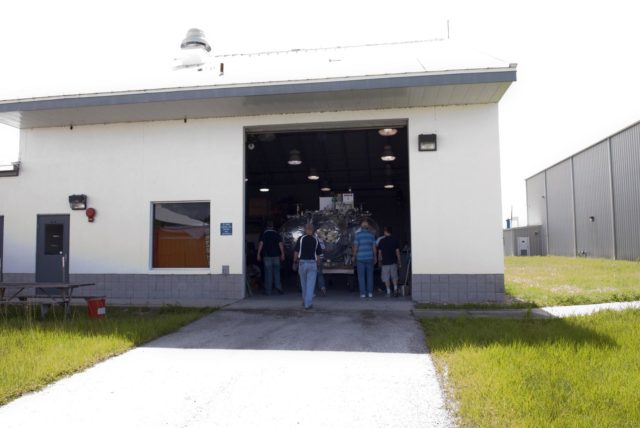 CAPE CANAVERAL, Fla. - NASA's Morpheus lander, a vertical test bed vehicle, has been moved into a building at the Shuttle Landing Facility, or SLF, at the Kennedy Space Center in Florida. Morpheus is designed to demonstrate new green propellant propulsion systems and autonomous landing and an Autonomous Landing and Hazard Avoidance Technology, or ALHAT, system.      Checkout of the prototype lander has been ongoing at NASA's Johnson Space Center in Houston in preparation for its first free flight. The SLF site will provide the lander with the kind of field necessary for realistic testing. Project Morpheus is one of 20 small projects comprising the Advanced Exploration Systems, or AES, program in NASA's Human Exploration and Operations Mission Directorate. AES projects pioneer new approaches for rapidly developing prototype systems, demonstrating key capabilities and validating operational concepts for future human missions beyond Earth orbit. For more information on Project Morpheus, visit http://www.nasa.gov/centers/johnson/exploration/morpheus/index.html  Photo credit: NASA/ Charisse Nahser KSC-2012-4031