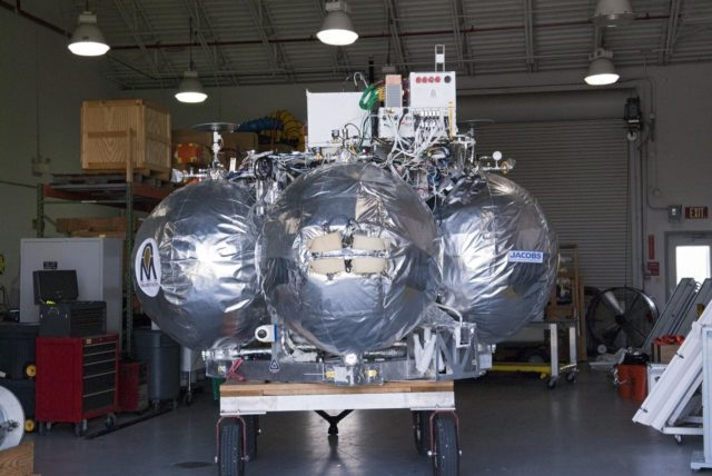 CAPE CANAVERAL, Fla. - NASA's Morpheus lander, a vertical test bed vehicle, has been moved into a building at the Shuttle Landing Facility, or SLF, at the Kennedy Space Center in Florida. Morpheus is designed to demonstrate new green propellant propulsion systems and autonomous landing and an Autonomous Landing and Hazard Avoidance Technology, or ALHAT, system.      Checkout of the prototype lander has been ongoing at NASA's Johnson Space Center in Houston in preparation for its first free flight. The SLF site will provide the lander with the kind of field necessary for realistic testing. Project Morpheus is one of 20 small projects comprising the Advanced Exploration Systems, or AES, program in NASA's Human Exploration and Operations Mission Directorate. AES projects pioneer new approaches for rapidly developing prototype systems, demonstrating key capabilities and validating operational concepts for future human missions beyond Earth orbit. For more information on Project Morpheus, visit http://www.nasa.gov/centers/johnson/exploration/morpheus/index.html  Photo credit: NASA/ Charisse Nahser KSC-2012-4032