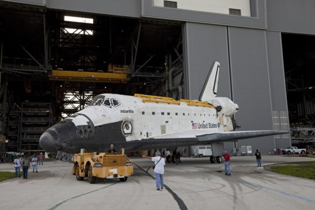 CAPE CANAVERAL, Fla. – United Space Alliance technicians monitor the space shuttle Atlantis as it moves out of the Vehicle Assembly Building at NASA's Kennedy Space Center in Florida. Atlantis is switching places with Endeavour which had been in Bay 2 of the Orbiter Processing Facility OPF. In the OPF, Atlantis will undergo final preparations for its transfer to the Kennedy Space Center Visitor Complex targeted for November. The work is part of Transition and Retirement of the remaining space shuttles, Atlantis and Endeavour. Atlantis is being prepared for public display at Kennedy's Visitor Complex. Over the course of its 26-year career, Atlantis spent 293 days in space during 33 missions. For more information, visit http://www.nasa.gov/transition Photo credit: NASA/Kim Shiflett KSC-2012-4507