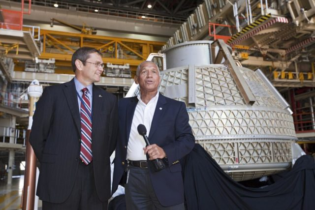 CAPE CANAVERAL, Fla. – NASA Administrator Charlie Bolden, right, and Boeing's Vice President and General Manager of Space Exploration John Elbon address the media inside Orbiter Processing Facility-3, or OPF-3, at NASA's Kennedy Space Center in Florida. Bolden took a few dozen media on a road show tour of the center and adjacent Cape Canaveral Air Force Station to show the progress being made for future government and commercial space endeavors that will begin from Florida's Space Coast. Boeing is leasing OPF-3 through an agreement with Space Florida for the manufacturing and assembly of its CST-100 spacecraft, which is under development in collaboration with NASA's Commercial Crew Program.          During his tour, Bolden announced that Space Exploration Technologies, or SpaceX, has completed its Space Act Agreement with NASA for Commercial Orbital Transportation Services. SpaceX is scheduled to launch the first of its 12 contracted cargo flights to the space station from Cape Canaveral this October, under NASA's Commercial Resupply Services Program. Bolden also announced NASA partner Sierra Nevada Corp. has conducted its first milestone under the agency's recently announced Commercial Crew Integrated Capability CCiCap initiative. The milestone, a program implementation plan review, marks an important first step in Sierra Nevada's efforts to develop a crew transportation system with its Dream Chaser spacecraft. Through NASA's commercial space initiatives and programs, the agency is providing investments to stimulate the American commercial space industry. Photo credit: NASA/Kim Shiflett KSC-2012-4600