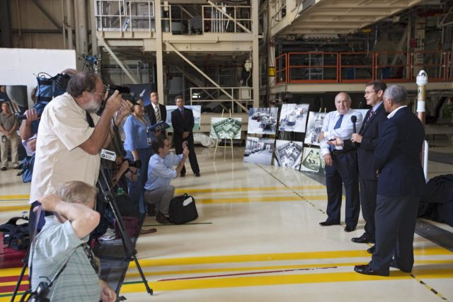 CAPE CANAVERAL, Fla. – Space Florida President Frank DiBello, NASA Administrator Charlie Bolden, and Boeing's Vice President and General Manager of Space Exploration John Elbon address the media inside Orbiter Processing Facility-3, or OPF-3, at NASA's Kennedy Space Center in Florida. Bolden took a few dozen media on a road show tour of the center and adjacent Cape Canaveral Air Force Station to show the progress being made for future government and commercial space endeavors that will begin from Florida's Space Coast. Boeing is leasing OPF-3 through an agreement with Space Florida for the manufacturing and assembly of its CST-100 spacecraft, which is under development in collaboration with NASA's Commercial Crew Program.      During his tour, Bolden announced that Space Exploration Technologies, or SpaceX, has completed its Space Act Agreement with NASA for Commercial Orbital Transportation Services. SpaceX is scheduled to launch the first of its 12 contracted cargo flights to the space station from Cape Canaveral this October, under NASA's Commercial Resupply Services Program. Bolden also announced NASA partner Sierra Nevada Corp. has conducted its first milestone under the agency's recently announced Commercial Crew Integrated Capability CCiCap initiative. The milestone, a program implementation plan review, marks an important first step in Sierra Nevada's efforts to develop a crew transportation system with its Dream Chaser spacecraft. Through NASA's commercial space initiatives and programs, the agency is providing investments to stimulate the American commercial space industry. Photo credit: NASA/Kim Shiflett KSC-2012-4602