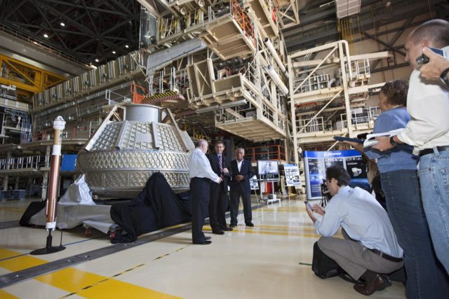 CAPE CANAVERAL, Fla. – Space Florida President Frank DiBello, NASA Administrator Charlie Bolden, and Boeing's Vice President and General Manager of Space Exploration John Elbon address the media inside Orbiter Processing Facility-3, or OPF-3, at NASA's Kennedy Space Center in Florida. Bolden took a few dozen media on a road show tour of the center and adjacent Cape Canaveral Air Force Station to show the progress being made for future government and commercial space endeavors that will begin from Florida's Space Coast. Boeing is leasing OPF-3 through an agreement with Space Florida for the manufacturing and assembly of its CST-100 spacecraft, which is under development in collaboration with NASA's Commercial Crew Program.    During his tour, Bolden announced that Space Exploration Technologies, or SpaceX, has completed its Space Act Agreement with NASA for Commercial Orbital Transportation Services. SpaceX is scheduled to launch the first of its 12 contracted cargo flights to the space station from Cape Canaveral this October, under NASA's Commercial Resupply Services Program. Bolden also announced NASA partner Sierra Nevada Corp. has conducted its first milestone under the agency's recently announced Commercial Crew Integrated Capability CCiCap initiative. The milestone, a program implementation plan review, marks an important first step in Sierra Nevada's efforts to develop a crew transportation system with its Dream Chaser spacecraft. Through NASA's commercial space initiatives and programs, the agency is providing investments to stimulate the American commercial space industry. Photo credit: NASA/Kim Shiflett KSC-2012-4603