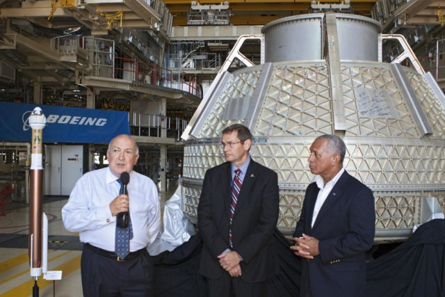 CAPE CANAVERAL, Fla. – Space Florida President Frank DiBello, NASA Administrator Charlie Bolden, and Boeing's Vice President and General Manager of Space Exploration John Elbon address the media inside Orbiter Processing Facility-3, or OPF-3, at NASA's Kennedy Space Center in Florida. Bolden took a few dozen media on a road show tour of the center and adjacent Cape Canaveral Air Force Station to show the progress being made for future government and commercial space endeavors that will begin from Florida's Space Coast. Boeing is leasing OPF-3 through an agreement with Space Florida for the manufacturing and assembly of its CST-100 spacecraft, which is under development in collaboration with NASA's Commercial Crew Program.    During his tour, Bolden announced that Space Exploration Technologies, or SpaceX, has completed its Space Act Agreement with NASA for Commercial Orbital Transportation Services. SpaceX is scheduled to launch the first of its 12 contracted cargo flights to the space station from Cape Canaveral this October, under NASA's Commercial Resupply Services Program. Bolden also announced NASA partner Sierra Nevada Corp. has conducted its first milestone under the agency's recently announced Commercial Crew Integrated Capability CCiCap initiative. The milestone, a program implementation plan review, marks an important first step in Sierra Nevada's efforts to develop a crew transportation system with its Dream Chaser spacecraft. Through NASA's commercial space initiatives and programs, the agency is providing investments to stimulate the American commercial space industry. Photo credit: NASA/Kim Shiflett KSC-2012-4605