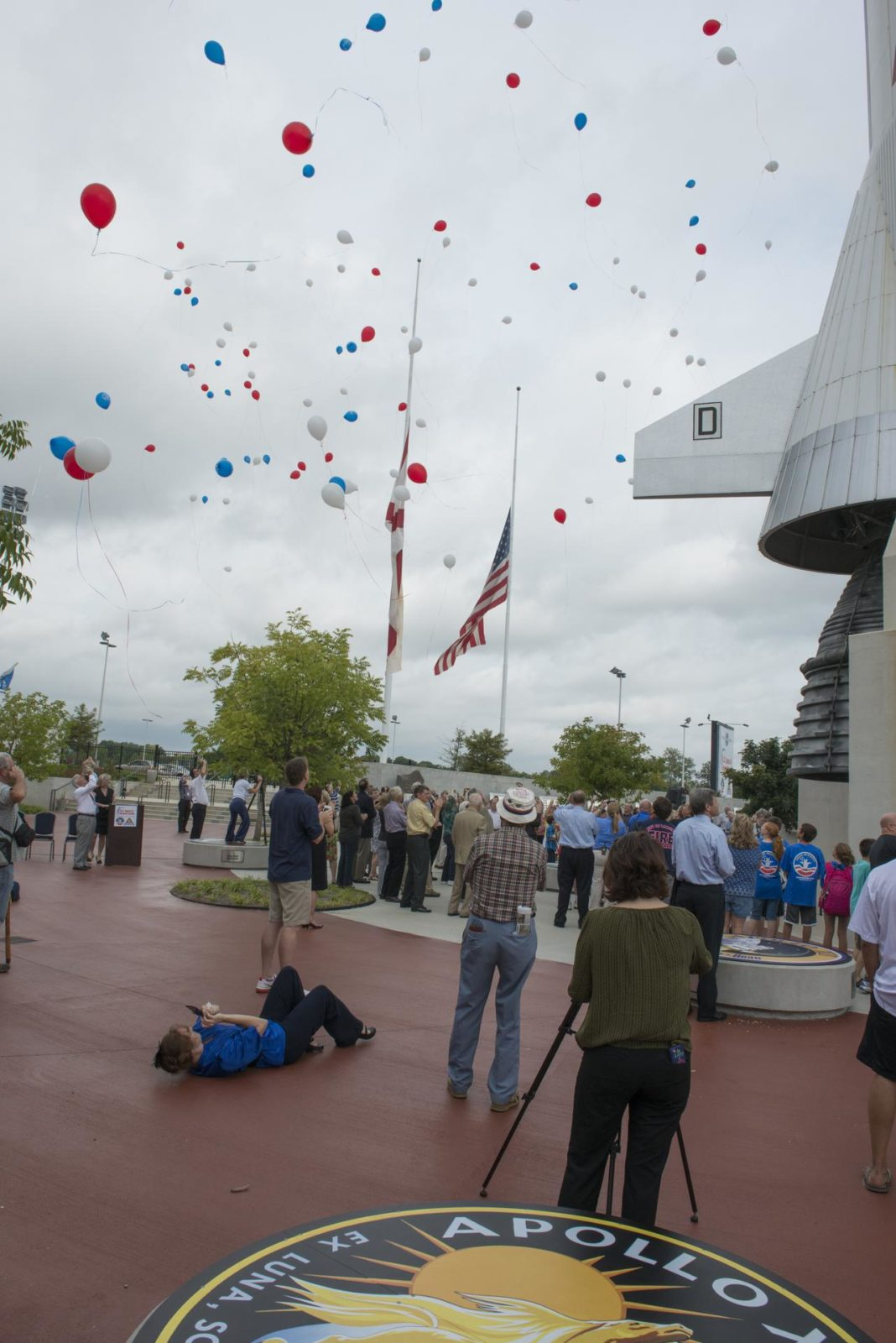 AUGUST 31, 2012 TRIBUTE TO APOLLO ASTRONAUT NEIL ARMSTRONG AT THE USSRC. A LARGE GROUP GATHERED NEAR THE LIFE-SIZE MODEL OF THE SATURN V ROCKET AND RELEASED RED, WHITE AND BLUE BALLOONS TO CELEBRATE THE LIFE OF NEIL ARMSTRONG. IN HONOR OF ARMSTRONG, FLAGS FLEW AT HALF-MAST ACROSS AMERICA ON AUGUST 31.1200934 1200934