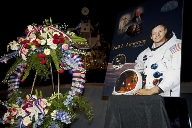 CAPE CANAVERAL, Fla. - Kennedy Space Center employees and guests gathered for a brief ceremony on Aug. 31, 2012 honoring Neil Armstrong, who died Aug. 25, 2012 at the age of 82. Armstrong was hailed by Center Director Bob Cabana as one of our heroes and a truly a great American. Cabana placed a wreath in the spaceport's Apollo-Saturn V Center.      Selected as an astronaut in 1962, Neil Armstrong flew on NASA's Gemini 8 with David Scott in March 1966 and the first lunar landing mission, Apollo 11, with Mike Collins and Buzz Aldine in July 1969. On July 20, 1969, he became the first human to walk on the moon. For more information, visit: http://www.nasa.gov/centers/kennedy/news/neil_armstrong.html Photo credit: NASA/Kim Shiflett KSC-2012-4810