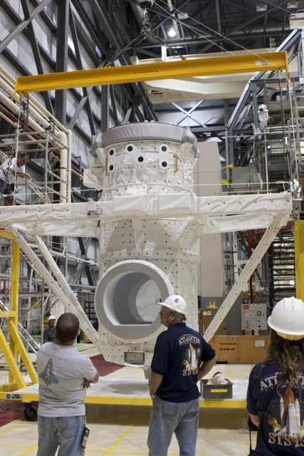 CAPE CANAVERAL, Fla. – At NASA's Kennedy Space Center in Florida, United Space Alliance technicians prepare a mock air lock for installation in the payload bay of the space shuttle Atlantis in Bay 2 of the Orbiter Processing Facility. Atlantis is undergoing final preparations for its transfer to the Kennedy Space Center Visitor Complex targeted for November.      The work is part of Transition and Retirement of the remaining space shuttles, Atlantis and Endeavour. Atlantis is being prepared for public display at Kennedy's Visitor Complex. Over the course of its 26-year career, Atlantis spent 293 days in space during 33 missions. For more information, visit http://www.nasa.gov/transition Photo credit: NASA/Jim Grossmann KSC-2012-4816