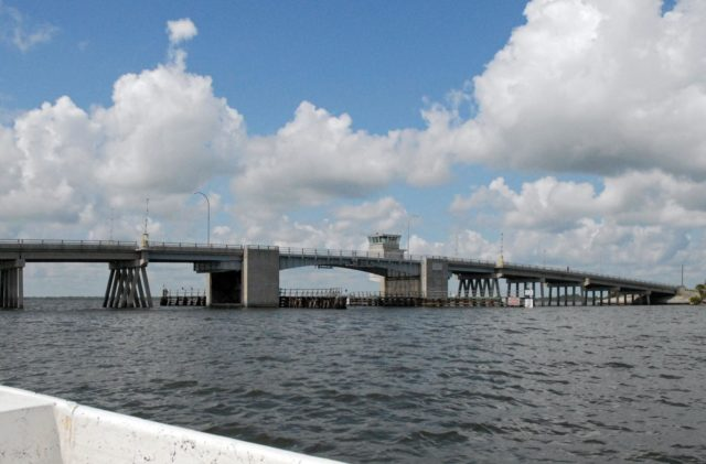 "CAPE CANAVERAL, Fla. – The Roy D. Bridges Jr. Bridge connecting NASA Kennedy Space Center's Industrial Area to Cape Canaveral Air Force Station's Industrial Area is seen during a field-guided boat tour. As part of the Kennedy's first-ever Innovation Expo, the tour, called ""Living Outdoor Laboratory for Environmental Sustainability,"" is giving employees the opportunity to see the unique estuarine ecosystems that are protected from development by the presence of the center and the Merritt Island National Wildlife Refuge.    The diverse and healthy area encompassing about 140,000 acres of central Florida's east coast has been closed to the public for 50 years, allowing the coastal dunes, saltwater estuaries and marshes, freshwater impoundments, scrub, pine flatwoods, and hardwood hammocks to provide habitats for more than 1,000 species of plants and animals. Innovation Expo is showcasing the innovative work taking place throughout the center's facilities and labs to encourage employees to work together to solve future challenges. For more information, visit http://www.nasa.gov/kennedy. Photo credit: NASA KSC-2012-4877"