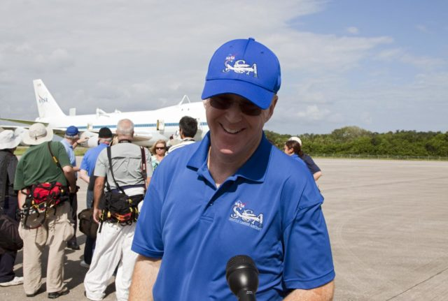 CAPE CANAVERAL, Fla. - Jeff Moultrie, pilot of the Shuttle Carrier Aircraft, or SCA, speaks with news media at the Shuttle Landing Facility at NASA's Kennedy Space Center in Florida. The SCA will take space shuttle Endeavour from Florida to Los Angeles for public display. Photo credit: NASA/Kim Shiflett KSC-2012-5024