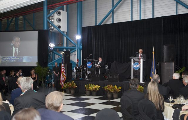 "CAPE CANAVERAL, Fla. – NASA Administrator Charlie Bolden speaks to attendees during Kennedy Space Center's 50th Anniversary Gala event at the Kennedy Space Center Visitor Complex Apollo/Saturn V Center in Florida. At left, on stage, is Master of Ceremony Jim Banke. The gala was coordinated by Kennedy and the National Space Club Florida Committee with the theme, ""Celebrating the Past and Preparing for the Future.""     The event was attended by about 650 current and retired NASA and contractor workers, dignitaries, and several former Kennedy Space Center directors. Photo credit: NASA/Kim Shiflett KSC-2012-5558"